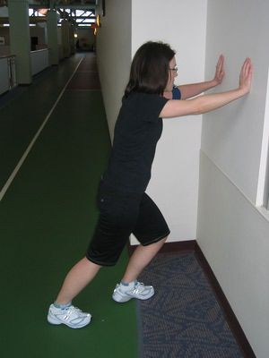 stretching on wall